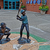 Statues of Boys Playing Baseball