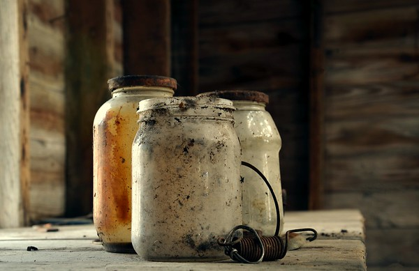 Old Jars with rusty lids, sepia.