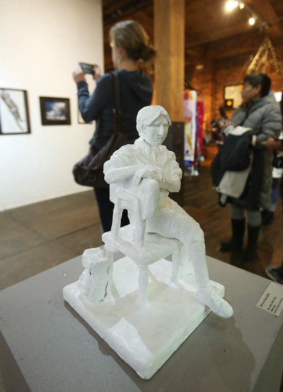 ". Student art show at Loading Dock Gallery. ""Girl in a Chair,\"" Clay, Wire, Wood & Foam, by Abbie Lyna of Innovation Academy Charter School. (SUN/Julia Malakie)"