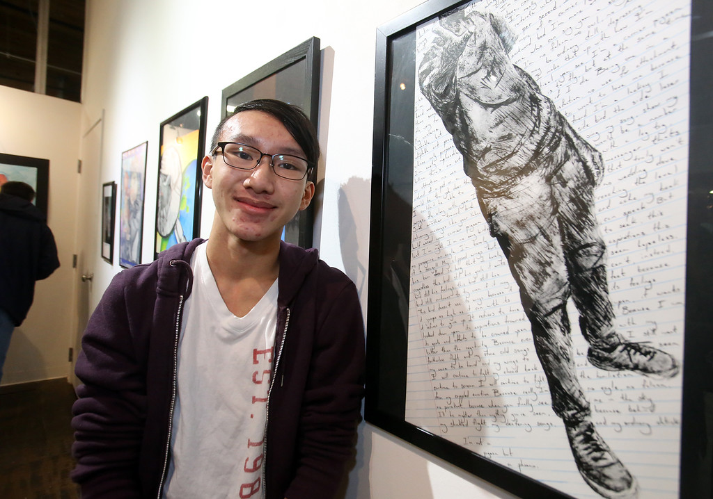 ". Student art show at Loading Dock Gallery. Lowell High junior Kevin Truong, 16, with his ink drawing, ""Mirror.\"" (SUN/Julia Malakie)"