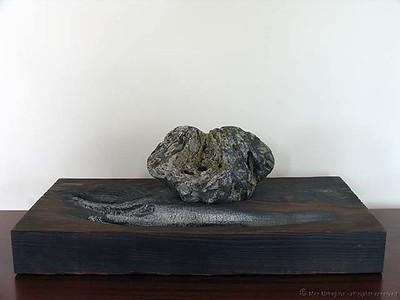 """9/11""; W 27"" x D 13"" x H 9 1/2""; stone on burned Douglas Fir  http://suisekiart.com/2007/07/07/suiseki-art-4-emotional-expression-911/"