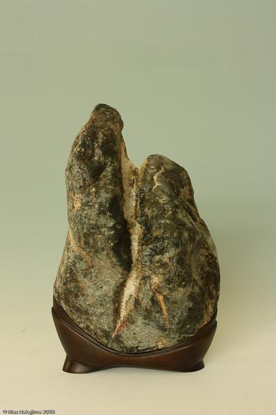 """""""Pietà"""" (慈悲 Jihi) 2008; W 10"""" x D 5 1/2"""" x H 15"""" ; Clear Creek serpentine and poplar wood"""