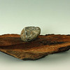 """13. Found Object, June 2008; W 21"""" x D 12"""" x H 5""""; Stone, Walnut with stain<br /> <br /> After setting the stone, Mas did some minor sanding and carving around the edge of the slab to harmonize with the stone, and lightly stained and varnished the wood to bring out and preserve the original walnut color."""
