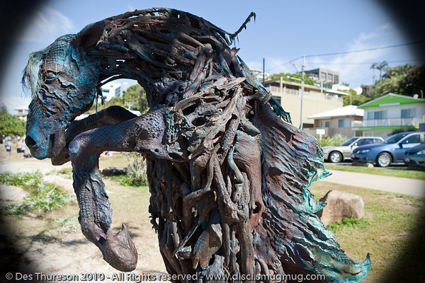 "God of the Sea with Attitude, by Jennie Scott - Swell Sculpture Festival, Pacific Parade, Currumbin Beach, Gold Coast, Australia; 15 September 2010. -  <a href=""http://www.swellsculpture.com.au"">http://www.swellsculpture.com.au</a>"