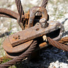 Rusty cable assembly showing pulley, shackle, split-pin and rusted nut and bolt