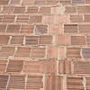 Red bricks with interesting texture on outside face of bricks