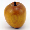 Apple carved from wood, showing the wood grain and detail of the stalk