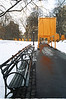 """The Gates"" near some of the 9,000 park benches; Central Park. NYC. Notice orange reflected in pavement!"