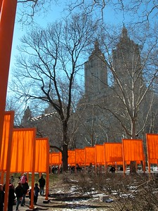 Christo and Jeanne-Claude. The 7,503 gates, 16 feet  tall  on  23 miles of walkways in Central Park. Free-hanging saffron colored fabric panels, suspended from the horizontal top part of the gates, came down to approximately 7 feet above the ground. The gates were spaced at 12 foot  intervals. The gates and the fabric panels were seen from far away through the leafless branches of the trees. The work of art remained for 16 days, then the gates were removed and the materials industrially recycled.