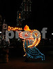 The neon angel stands about 7 feet tall acrross from the main zocolo in puebla mexico during the Christmas Holidays.
