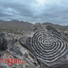 Saguaro National Park– Tucson, AZ<br /> Humankind has forever scratched out our creations in the desert.  Petroglyphs shaded by infrequent clouds..