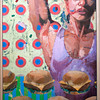 Woman Doing Tricep Extension with Organized Burgers in the Front of Her.<br /> Thomas Matthew Pierson, MFA Spring 2013