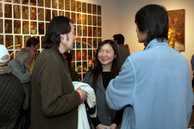 Victor Wang (left) talking to adjunct/alumni Grace Lin and alumni James Wu.