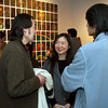 Victor Wang (left) talking to adjunct/alumni Grace Lin and alumni James Wu.