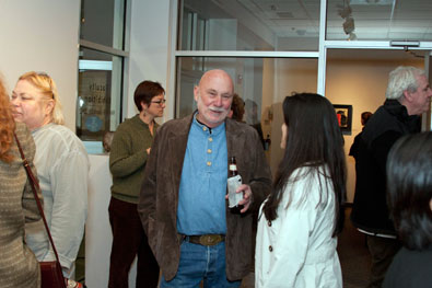 Hank Knickmeyer talking to graduate student Eliana Cristancho.