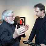 Tim Liddy (right) talking to alumni Don Tiemeier.