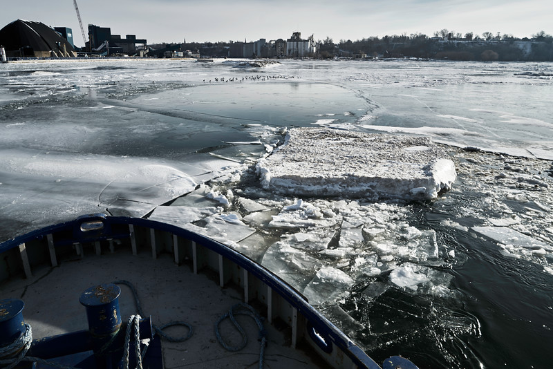 Untitled<br /> Breaking up substantially thick pans of ice.