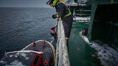 Ship's Pilot Disembarks The boarding and disembarking of pilots is often performed in challenging conditions and often at night. On this day we are lucky with the flat seas near Les Escoumins pilot station.on the remote north shore of the St. Lawrence River.