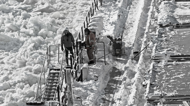 Untitled<br /> The St. Lawrence River is frozen. A pilot must board the ship at Les Escoumins and so the crew has been working through the night to clear enough of the deck that boarding may be possible.