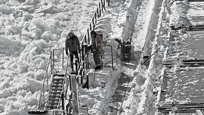 Untitled The St. Lawrence River is frozen. A pilot must board the ship at Les Escoumins and so the crew has been working through the night to clear enough of the deck that boarding may be possible.