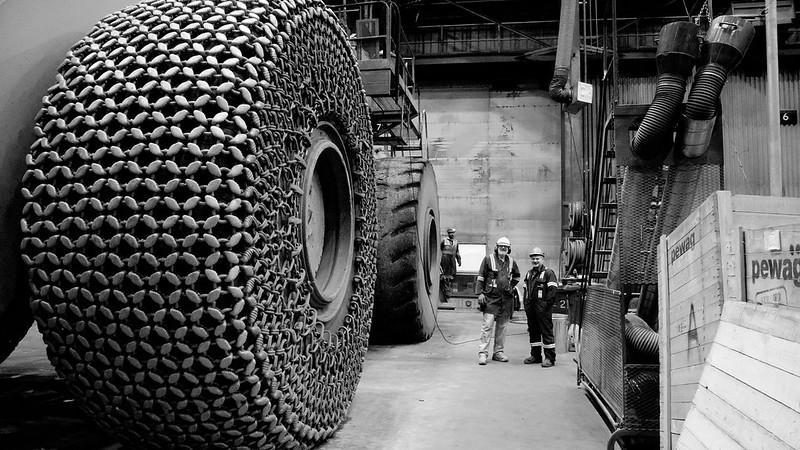 Snow Tires<br /> The truck maintenance facility in Mont-Wright. Gravel on the roads for traction must be a minimum of three inch diameter to withstand the weight of these trucks.