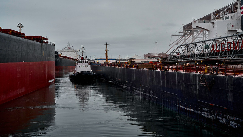 Valet Parking<br /> The Algo Lake is manoeuvred onto the wheat dock in the compact harbour of Port Cartier. Once she discharges her load of wheat she shall shift docks to receive ore pellets bound for Hamilton on Lake Ontario.