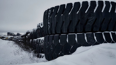 Guideposts Tires line the roads at Mont-Wright. It is staggering to think that each one of these tires costs $65K.