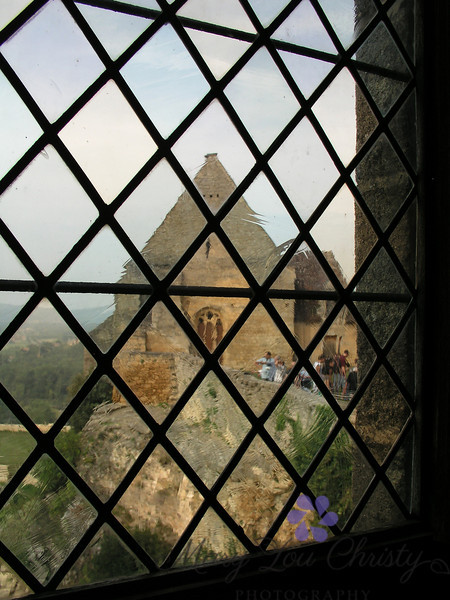 Through a medieval window. Castlenaud in France.
