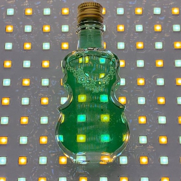 Bottle of absinthe that is really green apple schnapps, ca. 2001