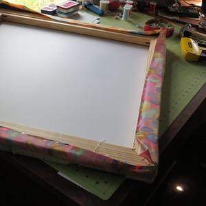 an industrial stapler and a canvas pliers make this a much easier task. Still it takes a bit of fiddling to make those corners lie down nicely.