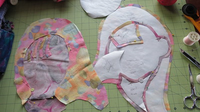 I started with an old photo of the two girls from about 4 years or so ago. I enlarge the photo--taken by my nephew--father of the two girls and then begin cutting out large pieces. I use freezer paper as my templates