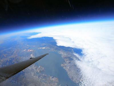 At 70,000 feet, dark space can be clearly seen above the curving earth.