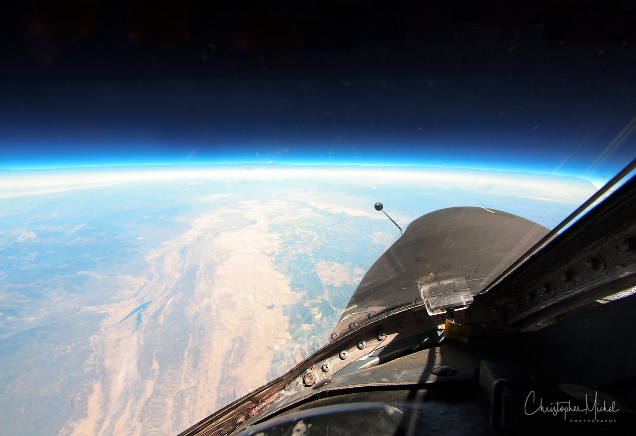 """Shot of the earth looking forward on the aircraft.  The """"rear view mirror"""" is used to detect contrails -- deadly when flying over hostile territory."""