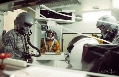 Christopher Michel in the pressure chamber...about to go up to 70,000 feet cabin altitude...and then experience a rapid decompression (photograph USAF)