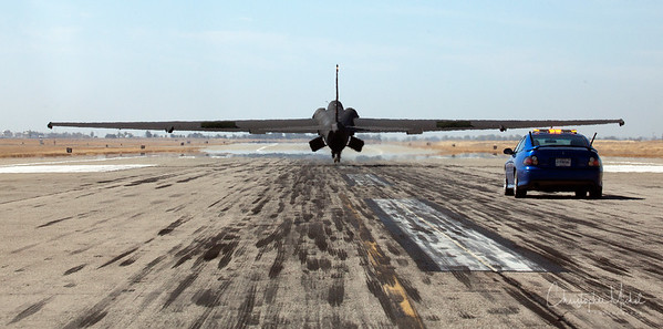 """U-2 landing with """"chase car"""" right behind it."""