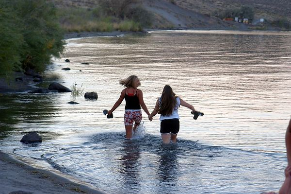 Molly and Lauren frolic off into the water at Vantage