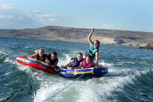 Capri rides the waves on top of Rachel and Catrina while Kenly and Lauren hold on with all their might