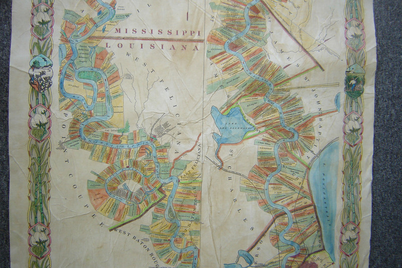 "1858 Plantation Map<br /> Hand Painted in exquisite Detail! <br /> <br /> 36"" x 57"" <br /> <br /> 1858 Plantation Map<br /> Price: $300<br /> <br /> <br /> <br />  <br /> <br /> This most limited edition map is beautifully hand colored and antiqued. Yes, you may commission specific styles and colors. 3 color schemes are included in this collection: Ivory, parchment, color detailed.<br /> <br /> ""Your Ivory map is beautiful!! He will love it! Thanks so much!""  ~ Seattle<br /> <br /> Antiqued, hand-painted reproduction of the PLANTATION MAP, 1858, South from Natchez, Mississippi, including parts of  Arkansas, and Louisiana. <br /> We currently have only 3 of these beautiful, large hand-painted maps available. Individual plantations are clearly labeled."