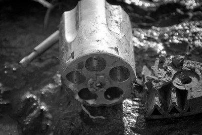 A close up of a revolver cylinder after it has been through the grinder. This image is not in the exhibit or book but I liked it so I included it here.