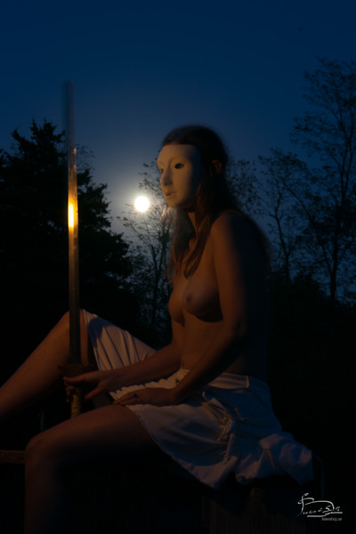 Woman, sword and full moon and reflection