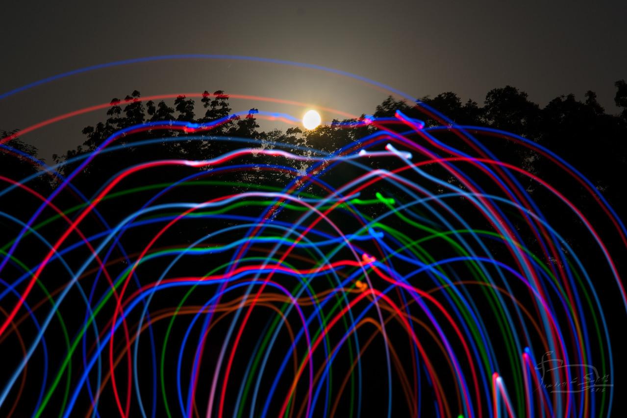 Rising full moon and LED sword lights