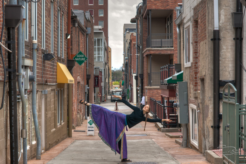 Chandra doing yoga in Alley A