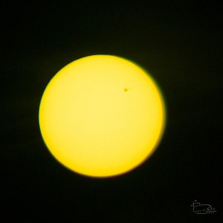 Venus transiting over the face of the sun, 5 June, 2012 Venus transiting over the face of the sun, 5 June, 2012.  280mm el cheapo telephoto, 1/500 at f6.7, ISO 200