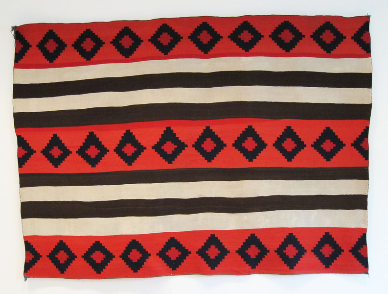 Navajo Second Phase Blanket with raveled bayeta in several shades, the interior of the diamonds the darkest.  54 x 72.