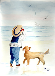 Boy with his dog on the beach