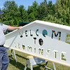 "Pete Lavoie inspects the new ""Welcome to Leominster"" sign, which was installed on the Leominster Connector on Thursday morning. SENTINEL & ENTERPRISE / Ashley Green"