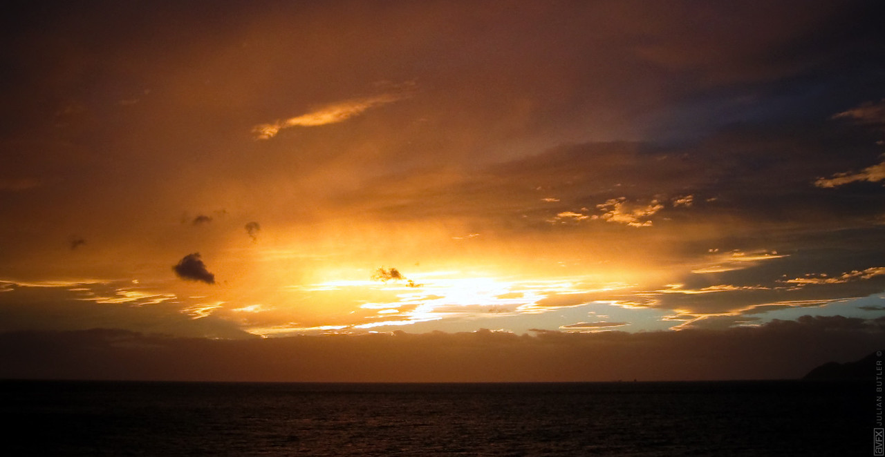 This is a sunset shot from the Cook Strait Ferry on the way back from a tramping trip in Queen Charlotte Sounds in the top of the South Island.