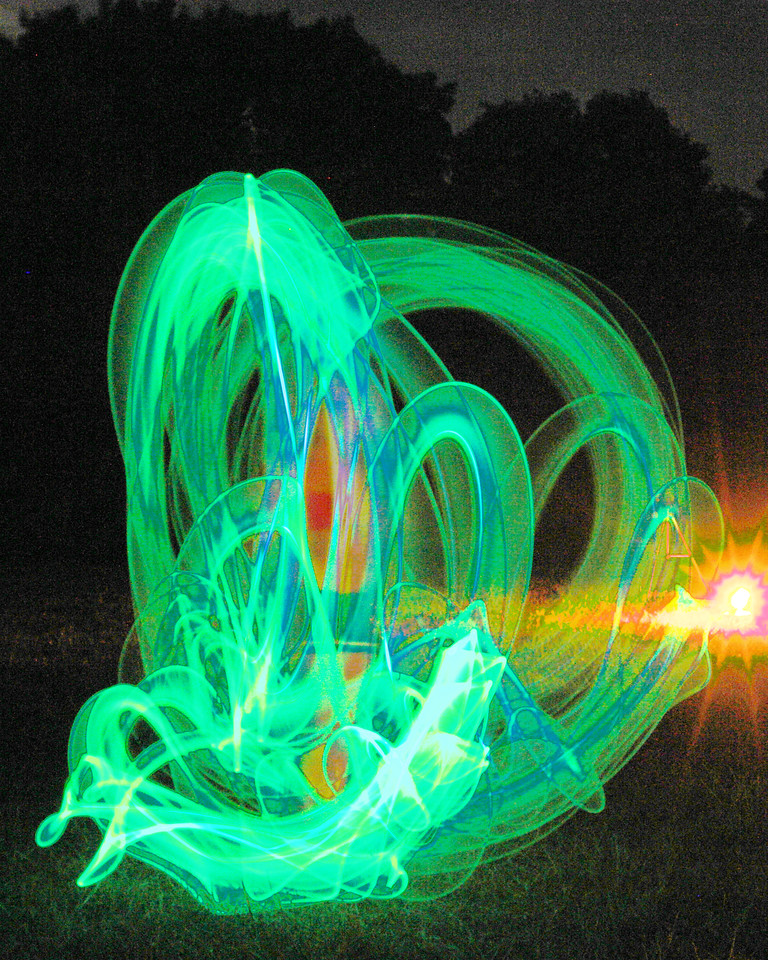 The previous light paintings used battery powered lights.  Glow sticks, the chemical based things that glow for a few hours once you activate them, put out very little light. The original of this one is nearly completely black.   Work with the curves tool allows me to bring out quite a bit of interesting detail as  Budda celebrated her 9th birthday with her first attempt at spinning.  However, there are some pronounced color shifts, which might or might not be acceptable.  Here I think it works.