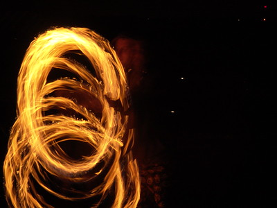 """When I saw my first fire performance show in 2005 at our local regional burning man event, Interfuse, I knew I had to capture the moving flames in a photograph.   It seemed obvious to me that I would need a tripod and a long exposure, and since I had a sturdy tripod with me, I made some pictures.    The second fire spinning picture I took, """"Spinner"""", was a four second exposure at f8.  The clarity of the flames and their pattern is very interesting, perhaps even more interesting than the blur of live action. But somehow the ghostly image of the person doing the spinning didn't seem to fit into the design as well as the impression of what I saw with my eyes."""