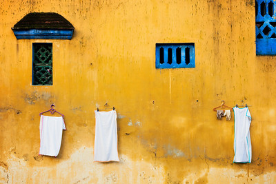 """Vietnamese Laundry""  Yellow Wall in Hoi An, Vietnam.  © 2011 - Nicole S. Young"